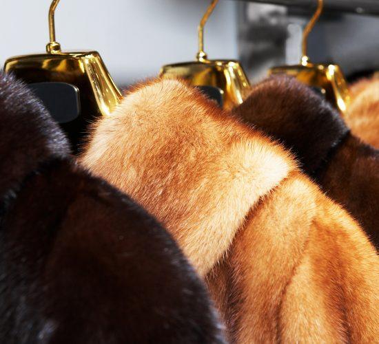 Rich female fur coats on sale in shop